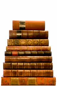 img_7378-stack-of-books-dark-background-q90-1100x1800